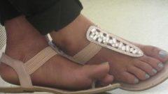 Flirtatious Indian Crossed Feet
